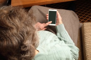 Elder woman with smartphone on her hand