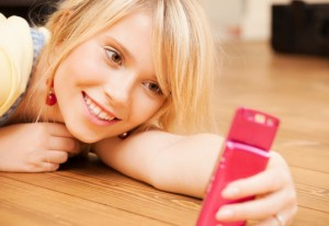 teenage girl making self portrait with smartphone